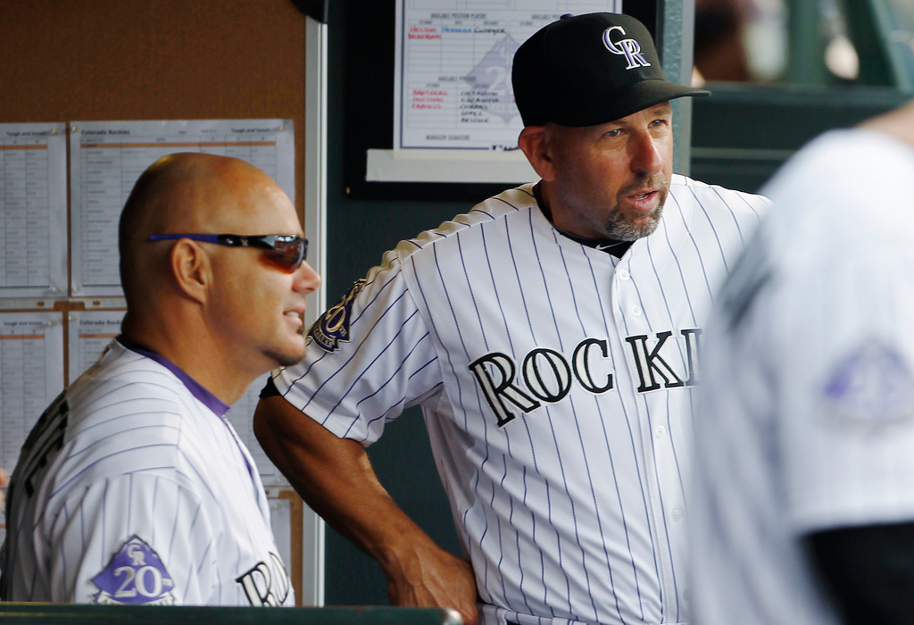 . Colorado Rockies manager Walt Weiss, right, confers with batting coach Dante Bichette as the Rockeis face the Pittsburgh Pirates in the fourth inning a baseball game in Denver on Sunday, Aug. 11, 2013. (AP Photo/David Zalubowski)