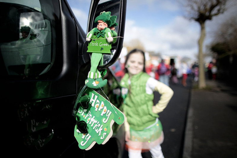 . A leprechaun hangs from a bus mirror during the St. Patrick\'s Day parade in Limerick, Ireland, Sunday, March 17, 2013.  (AP Photo/Peter Morrison)