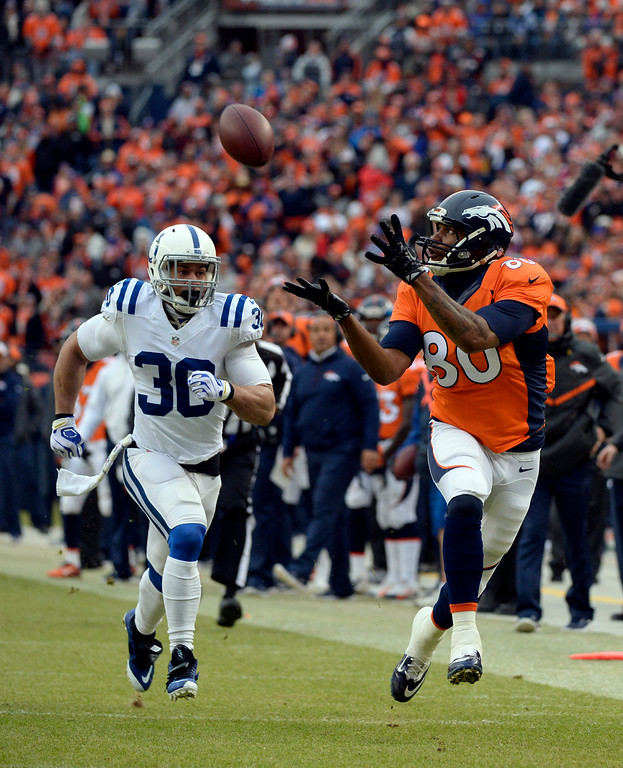 . Julius Thomas (80) of the Denver Broncos makes a catch taking the ball down to the one yard line in the first quarter.  The Denver Broncos played the Indianapolis Colts in an AFC divisional playoff game at Sports Authority Field at Mile High in Denver on January 11, 2015. (Photo by Brent Lewis/The Denver Post)