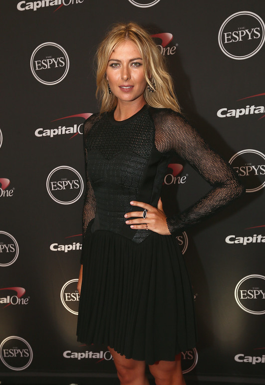 . LOS ANGELES, CA - JULY 16:  Tennis player Maria Sharapova presents award for Best Game at The 2014 ESPYS at Nokia Theatre L.A. Live on July 16, 2014 in Los Angeles, California.  (Photo by Christopher Polk/Getty Images For ESPYS)