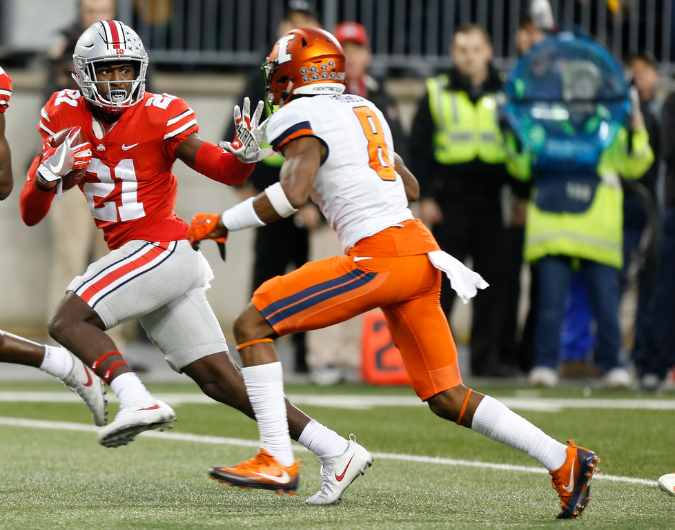 . Ohio State receiver Parris Campbell, left, fends off Illinois defensive back Nate Hobbs during the first half of an NCAA college football game Saturday, Nov. 18, 2017, in Columbus, Ohio. (AP Photo/Jay LaPrete)