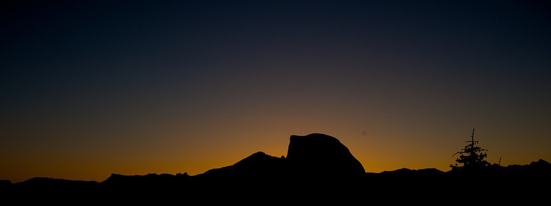 Half Dome silhouetted against a pre-dawn sky
