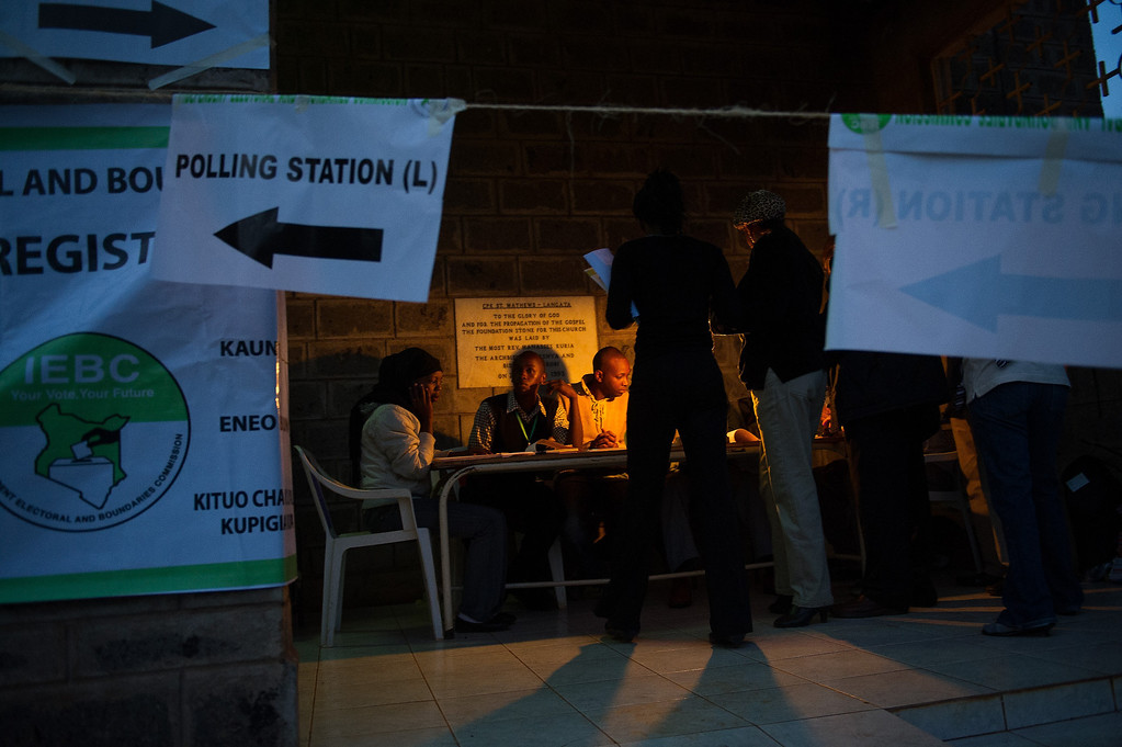 . Staff from the Independent Electoral and Boundaries Commission (IEBC) prepare for the opening of a polling station in the Langata constituency of Nairobi, Kenya on March 4, 2013. Long lines of Kenyans queued from far before dawn to vote Monday in the first election since the violence racked polls five years ago, with a deadly police ambush hours before polling started marring the key ballot. The tense elections are seen as a crucial test for Kenya, with leaders vowing to avoid a repeat of the bloody 2007 to 2008 post poll violence in which over 1,100 people were killed, with observers repeatedly warning of the risk of renewed conflict.    PHIL MOORE/AFP/Getty Images