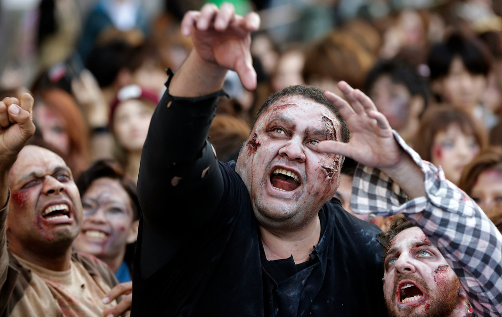 . Former sumo grand champion Akebono, center, and other participants in zombie costumes, perform during a Halloween event at Tokyo Tower in Tokyo, Thursday, Oct. 31, 2013. (AP Photo/Shizuo Kambayashi)