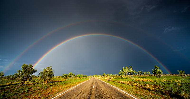 Chasing storms down endless Australian roads when a gorgeous double rainbow showed the way! #BBCMonsoon