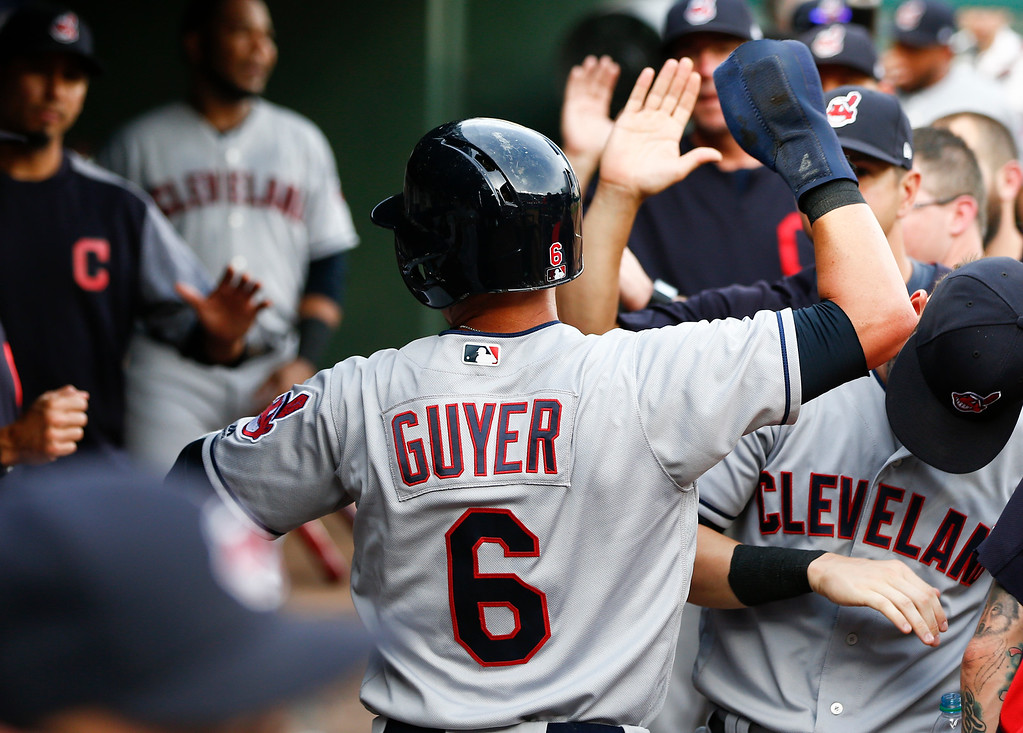 . Cleveland Indians\' Brandon Guyer (6) celebrates his run scored with teammates on a single by Yandy Diaz against the Texas Rangers during the second inning of a baseball game, Friday, July 20, 2018, in Arlington, Texas. (AP Photo/Jim Cowsert)