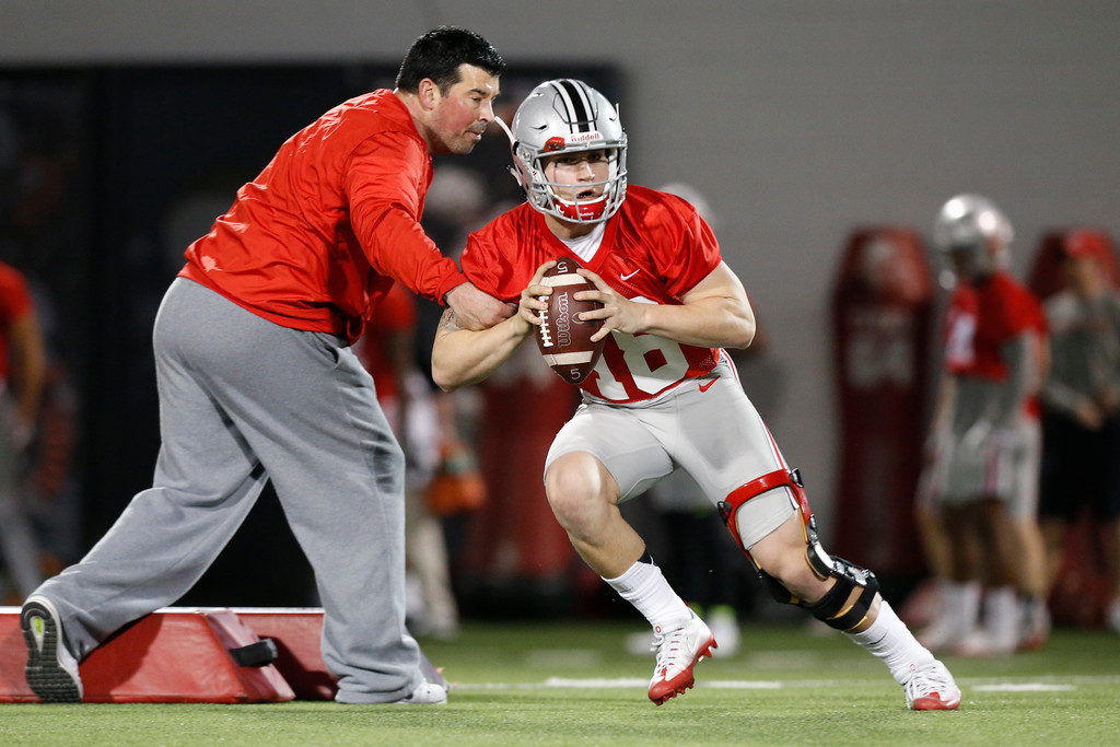 . Ohio State quarterback Tate Martell runs a drill during their Spring NCAA college football practice Tuesday, March 7, 2017, in Columbus, Ohio. (AP Photo/Jay LaPrete)