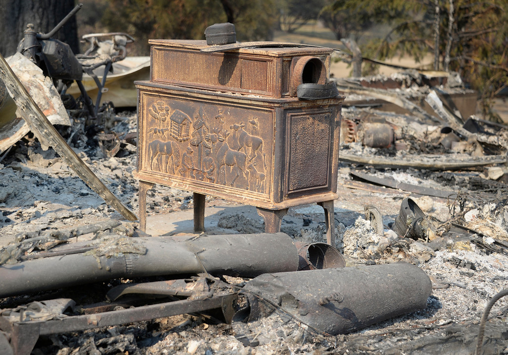. Very little remains of personal items after homes were destroyed during the Mountain Fire near Idyllwild, California July 18, 2013. The blaze erupted on Monday afternoon about 100 miles (161 km) east of Los Angeles in the scenic but rugged San Jacinto Mountains that overlook Palm Springs, Rancho Mirage and several smaller desert towns.  Photo by Gene Blevins/LA Dailynews