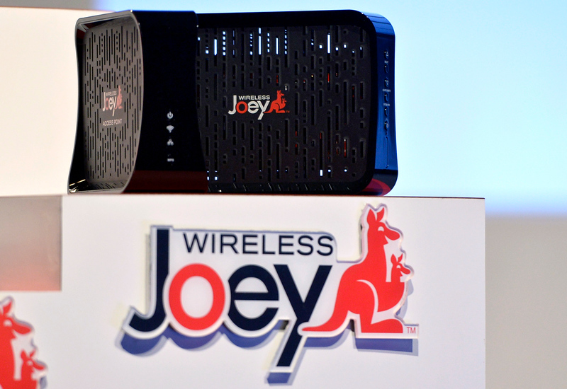 . Dish shows off the new wireless Joey during the Dish news conference at the 2014 International Consumer Electronics Show Monday, Jan. 6, 2014, in Las Vegas. (AP Photo/Jack Dempsey)