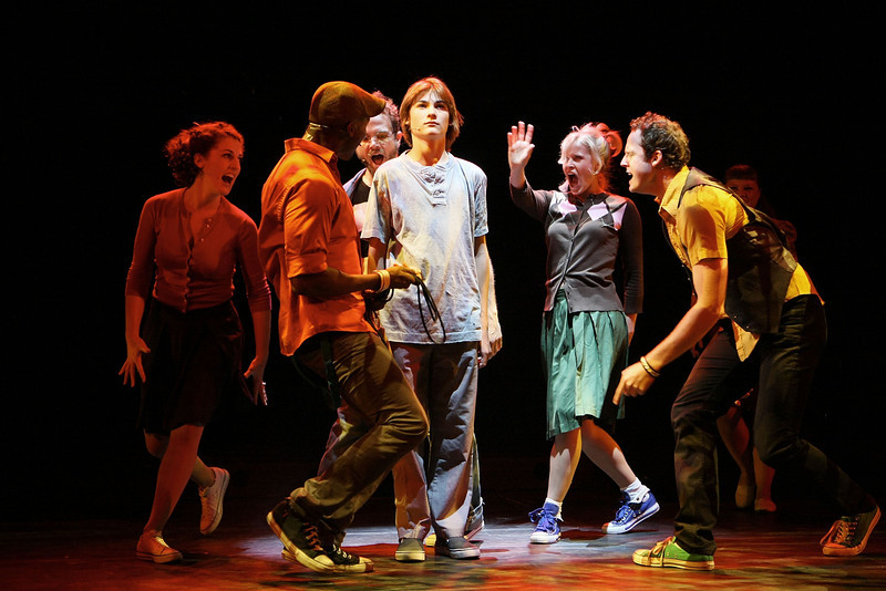 """HOLLYWOOD, CA - JUNE 17: Cast member actor Lorenzo Doryon (Middle) performs surounded by the ensemble cast during the dress rehearsal of The Who's """"Tommy"""" held at the Richardo Montalban Theatre on June 17, 2008 in Hollywood, California.  (Photo by Ryan Miller/Capture Imaging)"""