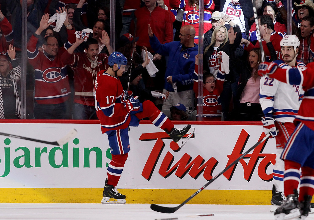 . MONTREAL, QC - MAY 17:  Rene Bourque #17 of the Montreal Canadiens celebrates his second period goal against the New York Rangers in Game One of the Eastern Conference Finals of the 2014 NHL Stanley Cup Playoffs at the Bell Centre on May 17, 2014 in Montreal, Canada.  (Photo by Bruce Bennett/Getty Images)