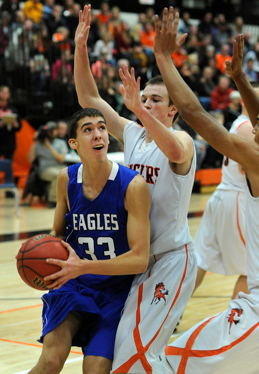 . Eagles center Brandon Hull (33) looked for the basket in the first half. The Lewis-Palmer High School boy\'s basketball team defeated Broomfield 75-53 Friday night, December 7, 2012.  Karl Gehring/The Denver Post