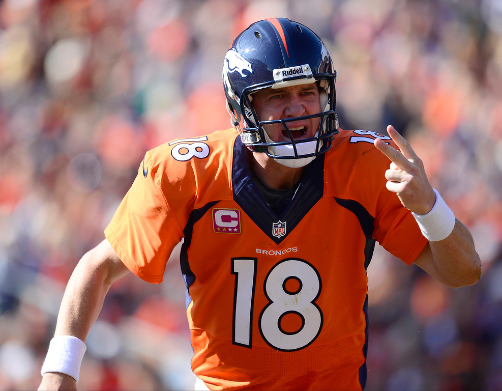 . Denver Broncos quarterback Peyton Manning (18) protests a call in the first quarter.  (Photo by AAron Ontiveroz/The Denver Post)