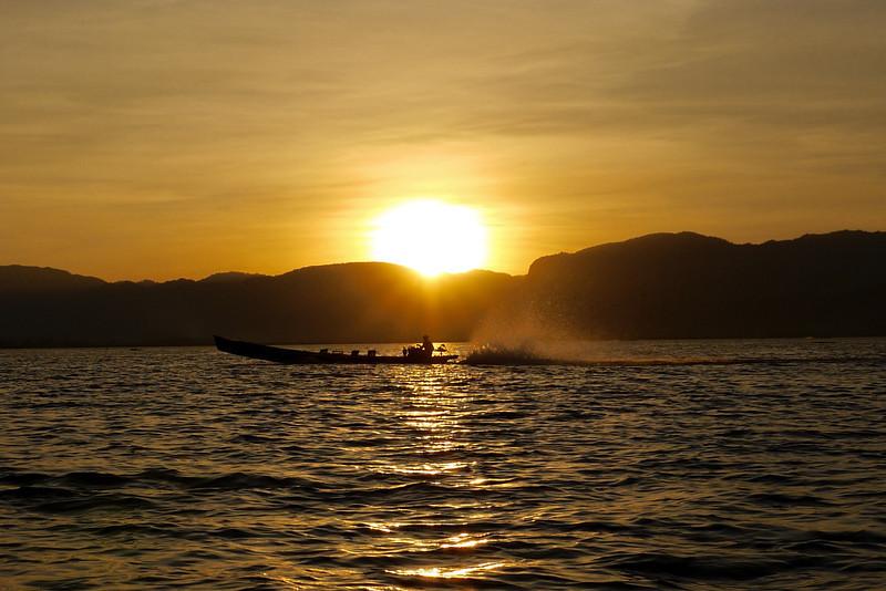 Sunset and a boat on Inle Lake, Burma (Myanmar).