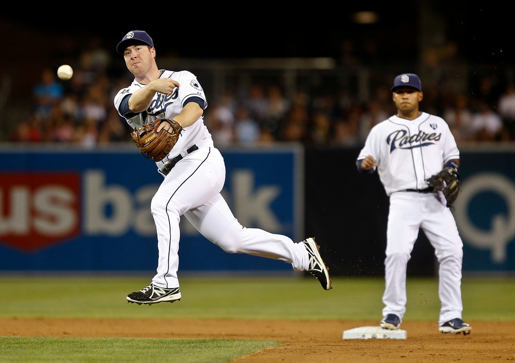 . San Diego Padres second baseman Jedd Gyorko throws out Colorado Rockies\' Josh Rutledge after fielding a slow roller in the sixth inning of a baseball game Tuesday, Aug. 12, 2014, in San Diego. (AP Photo/Lenny Ignelzi)