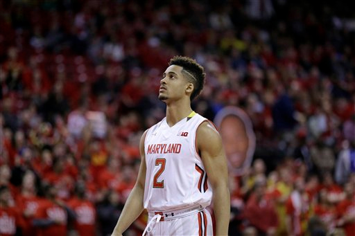 . Maryland guard Melo Trimble walks on the court before an NCAA college basketball game against Michigan, Saturday, Feb. 28, 2015, in College Park, Md. (AP Photo/Patrick Semansky)