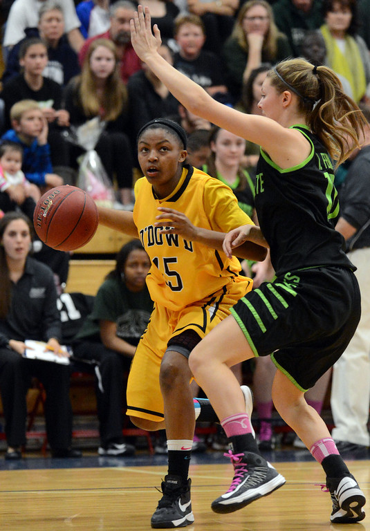. Bishop O\'Dowd High\'s Aisia Robertson (15) left, looks for a shot as Miramonte High\'s Kaitlin Fenn (10) blocks in the first period of their Division III North Coast Section basketball game in Dublin, Calif., on Saturday, March 2, 2013. Bishop O\'Dowd High went on to win the game 77-48. (Doug Duran/Staff)