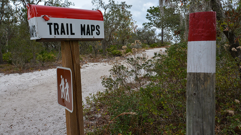 Mailbox with words trail maps on it