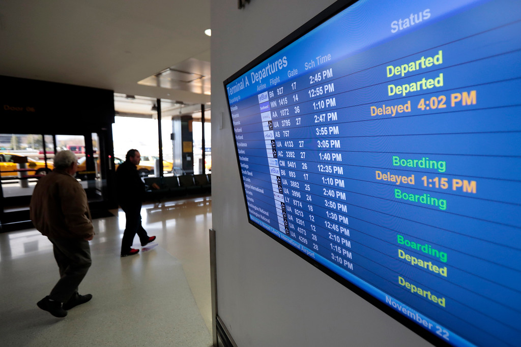 . Flight information appears on a screen at Newark Liberty International Airport, Tuesday, Nov. 22, 2016, in Newark, N.J. (AP Photo/Julio Cortez)
