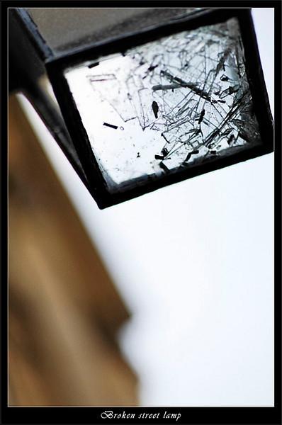 Shards of glass in a broken iron street lamp (80361792).jpg
