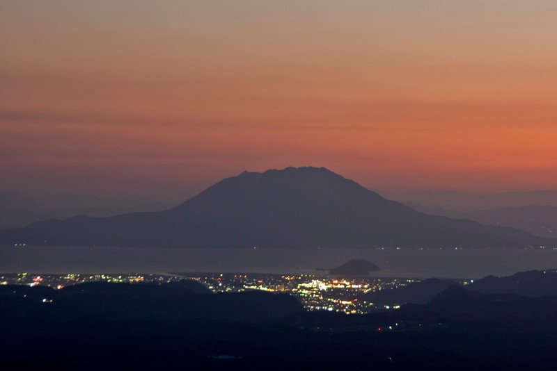 City lights and a colorful sunset in Kirishima Mountain, Japan
