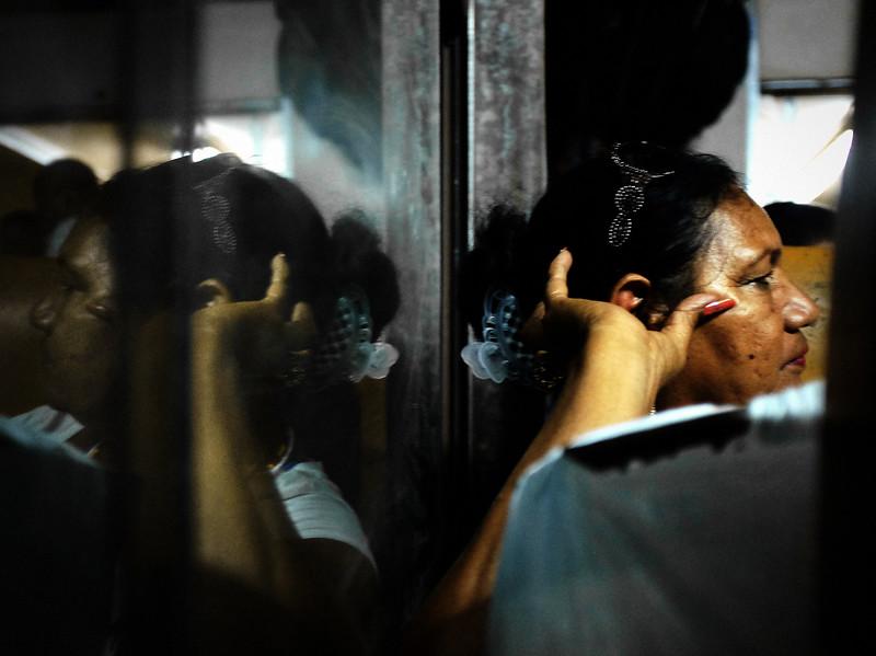 A woman talks with her neighbor near Aguacate, Cuba during the ride from Havana to Santiago de Cuba.