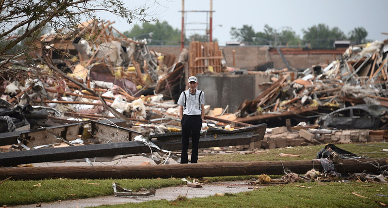 . A man stands among the wreckage after a tornado struck Moore, Oklahoma, May 20, 2013. A huge tornado with winds of up to 200 miles per hour (320 kph) devastated the Oklahoma City suburb of Moore on Monday, ripping up at least two elementary schools and a hospital and leaving a wake of tangled wreckage. REUTERS/Gene Blevins