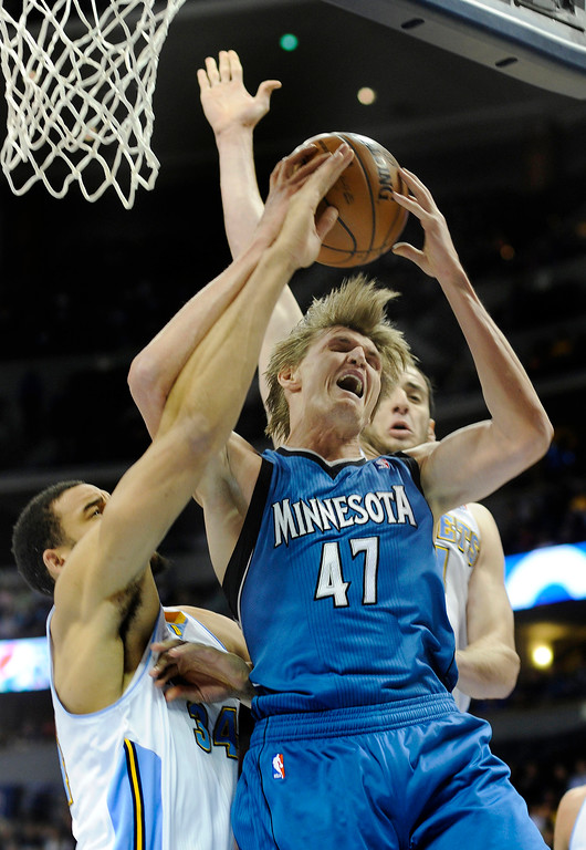 . Wolves forward Andrei Kirilenko (47) went to the hoop between Denver defenders JaVale McGee and Kosta Koufos in the first half. The Denver Nuggets hosted the Minnesota Timberwolves at the Pepsi Center Thursday night, January 3, 2013. Karl Gehring/The Denver Post