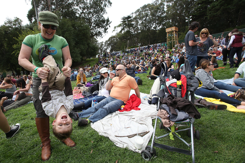 . Tracy Mongold, left, of Santa Cruz, plays with her son Sinjin, 4, near the Twin Peaks stage during the 6th annual Outside Lands Music and Arts Festival in Golden Gate Park in San Francisco, Calif., on Friday, Aug. 9, 2013.  (Jane Tyska/Bay Area News Group)