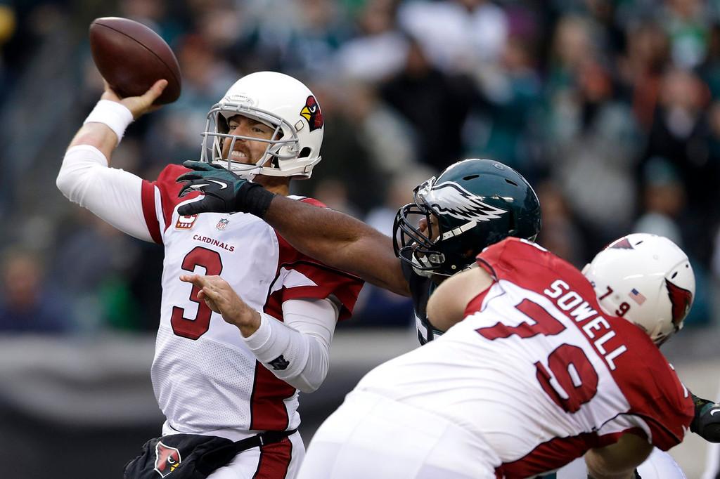 . Arizona Cardinals\' Carson Palmer passes under pressure from Philadelphia Eagles\' Brandon Graham during the second half of an NFL football game, Sunday, Dec. 1, 2013, in Philadelphia. (AP Photo/Matt Rourke)