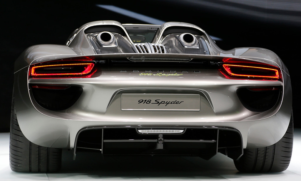 . The new Porsche 918 Spyder is displayed during the first press day of the 65th Frankfurt Auto Show in Frankfurt, Germany, Tuesday, Sept. 10, 2013.  (AP Photo/Frank Augstein)