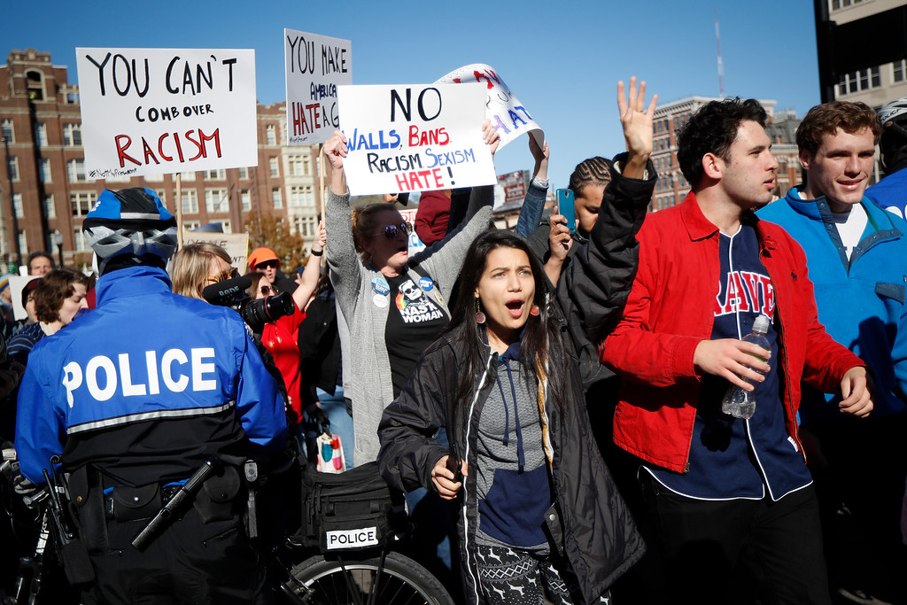 . Protestors march through downtown after a mistrial was declared due to a hung jury in the murder trial against Ray Tensing, Saturday, Nov. 12, 2016, in Cincinnati. Tensing, a white former University of Cincinnati police officer, was charged with murder in the shooting of Sam DuBose, an unarmed black motorist, while on duty during a routine traffic stop on July 19, 2015. (AP Photo/John Minchillo)