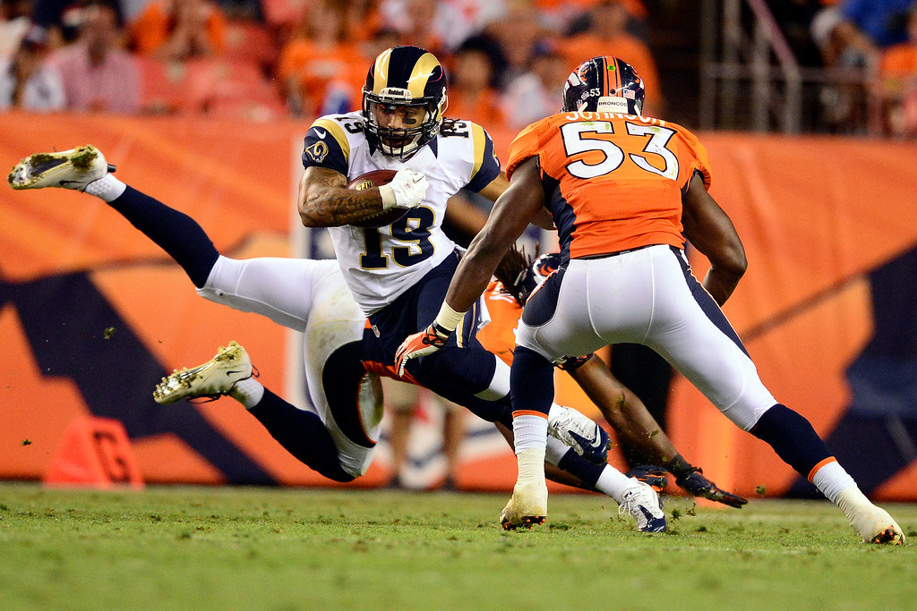 . DENVER, CO - AUGUST 24: Justin Veltung (19) of the St. Louis Rams runs the ball as Steven Johnson (53) of the Denver Broncos sets for a stop during the second half of action of an NFL preseason game at Sports Authority Field at Mile High on August 24, 2013. This is the third game of the preseason for the Broncos. (Photo by AAron Ontiveroz/The Denver Post)