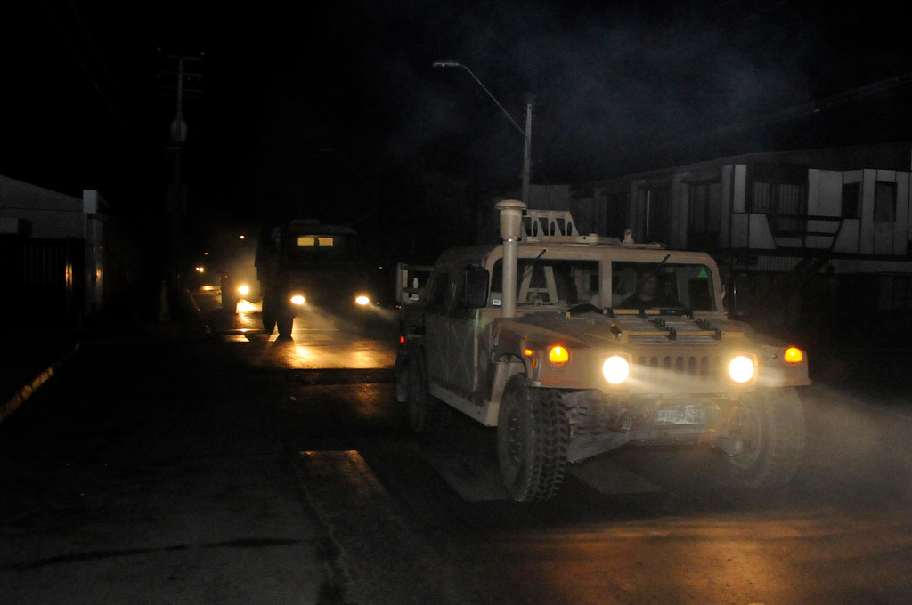 . A military vehicle patrols after an earthquake in Iquique, Chile, Tuesday, April 1, 2014. A powerful magnitude-8.2 earthquake struck off Chile\'s northern coast Tuesday night. A powerful magnitude-8.2 earthquake struck off northern Chile on Tuesday night, setting off a small tsunami that forced evacuations along the country\'s entire Pacific coast. (AP Photo/Cristian Viveros)