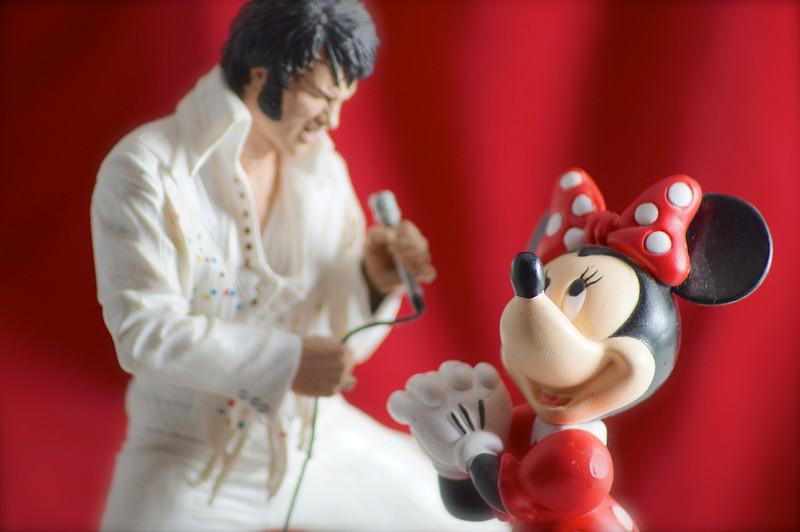 Minnie Mouse adoring Elvis action figure.