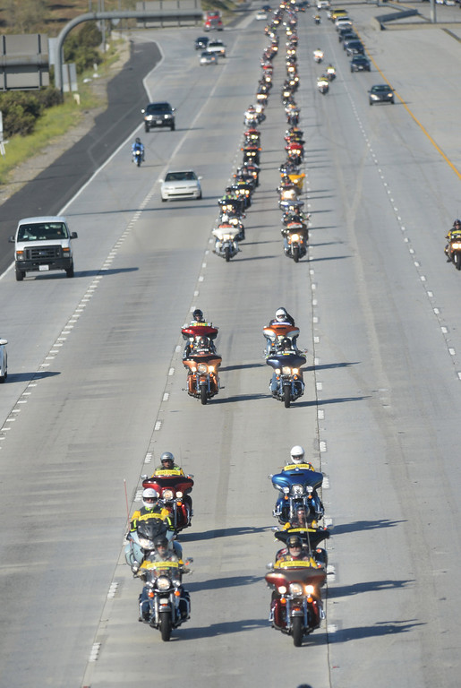""". Run For The Wall motorcycle riders pass through Fontana, Ca., on Interstate 15, heading to the Vietnam Memorial Wall in Washington D.C., Wednesday, May 14, 2014. Hundreds of \""""Run For The Wall\"""" motorcycle riders gathered at Victoria Gardens in Rancho Cucamonga, Ca., Wednesday morning to begin their the two week journey across the United States, May 14, 2014. Groups of riders will meet with other groups along the way, ending in Washington D.C. at the Vietnam Memorial Wall. The mission is promote healing among all veterans and their families from all wars, and to support our military personnel all over the world. (Photo by John Valenzuela/Inland Valley Daily Bulletin)"""