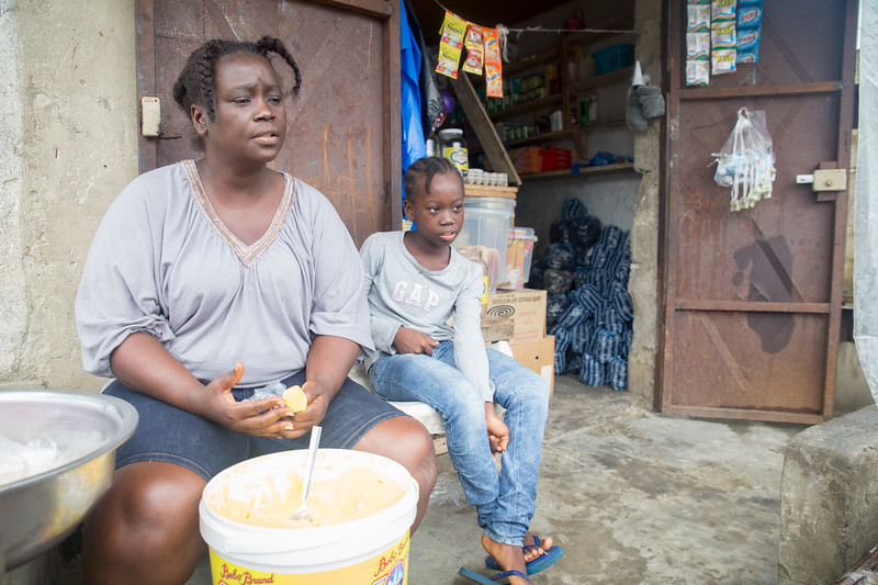 Monrovia, Liberia October 6, 2017 - Jacqueline Clinton,  a student in the REVSLA program who owns her own general store, works with her daughter.