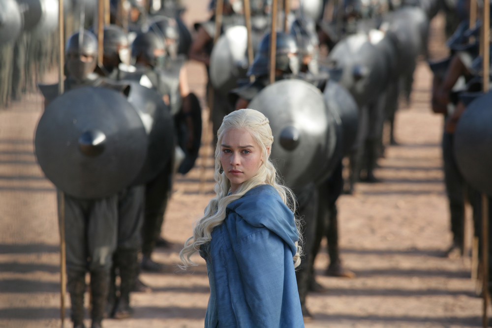 ". This publicity image released by HBO shows Emilia Clarke in a scene from ""Game of Thrones.\"" The program was nominated for an Emmy Award for outstanding drama series on, Thursday July 18, 2013. Clarke was also nominated for best supporting actress. The Academy of Television Arts & Sciences\' Emmy ceremony will be hosted by Neil Patrick Harris. It will air Sept. 22 on CBS.. (AP Photo/HBO, Keith Bernstein)"