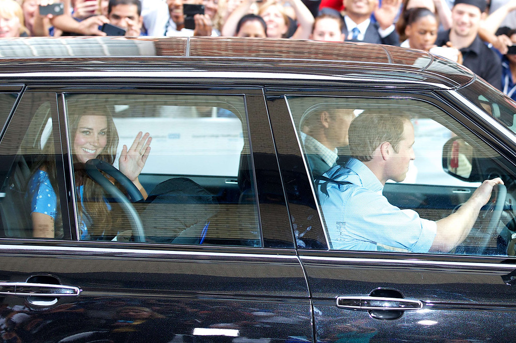 . Catherine, Duchess of Cambridge (L) waves as she is driven by her husband, WIlliam, the Duke of Cambridge away from Lindo Wing of St Mary\'s Hospital in London on July 23, 2013. Her baby was born on Monday afternoon weighing eight pounds six ounces (3.8 kilogrammes). The baby is directly in line to inherit the throne after Charles, Queen Elizabeth II\'s eldest son and heir, and his eldest son William.  ANDREW COWIE/AFP/Getty Images