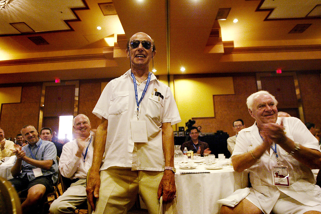 """. PALM SPRINGS, CA - APRIL 16:  Richard Sousa stands to the left of his partner of 52 years, Geri Pranger, as they are applauded after a speaker made a point about gay marriage at the 2004 Log Cabin Republicans National Convention and Liberty Education Forum National Symposium April 16, 2004 in Palm Springs, California. Convention officials say that this is the most important convention in the organization\'s history taking place during \""""the most important time in the movement for civil rights for all Americans.\"""" The Log Cabin Republicans represent conservative gays and lesbians.  (Photo by David McNew/Getty Images)"""