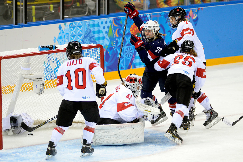 . Kendall Coyne (26) of the U.S.A. celebrates her goal on Florence Schelling (41) of the Switzerland during the third period of the United States\' 9-0 win at the Shayba Arena. Sochi 2014 Winter Olympics on Monday, February 10, 2014. (Photo by AAron Ontiveroz/The Denver Post)