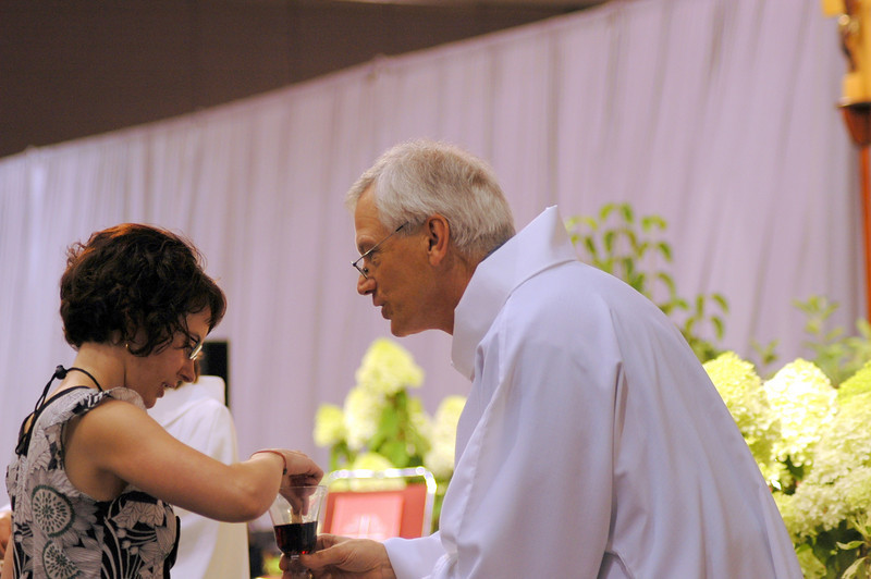 Secretary David Swartling distributing Holy Communion at opening worship.