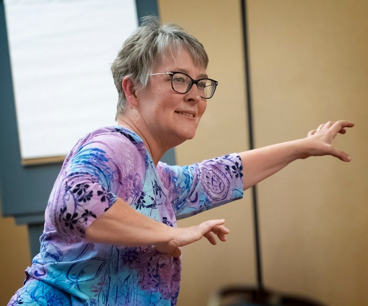 Holli Rainwater demonstrates qi·gong, which informed her book, The Curve of Her Arm.