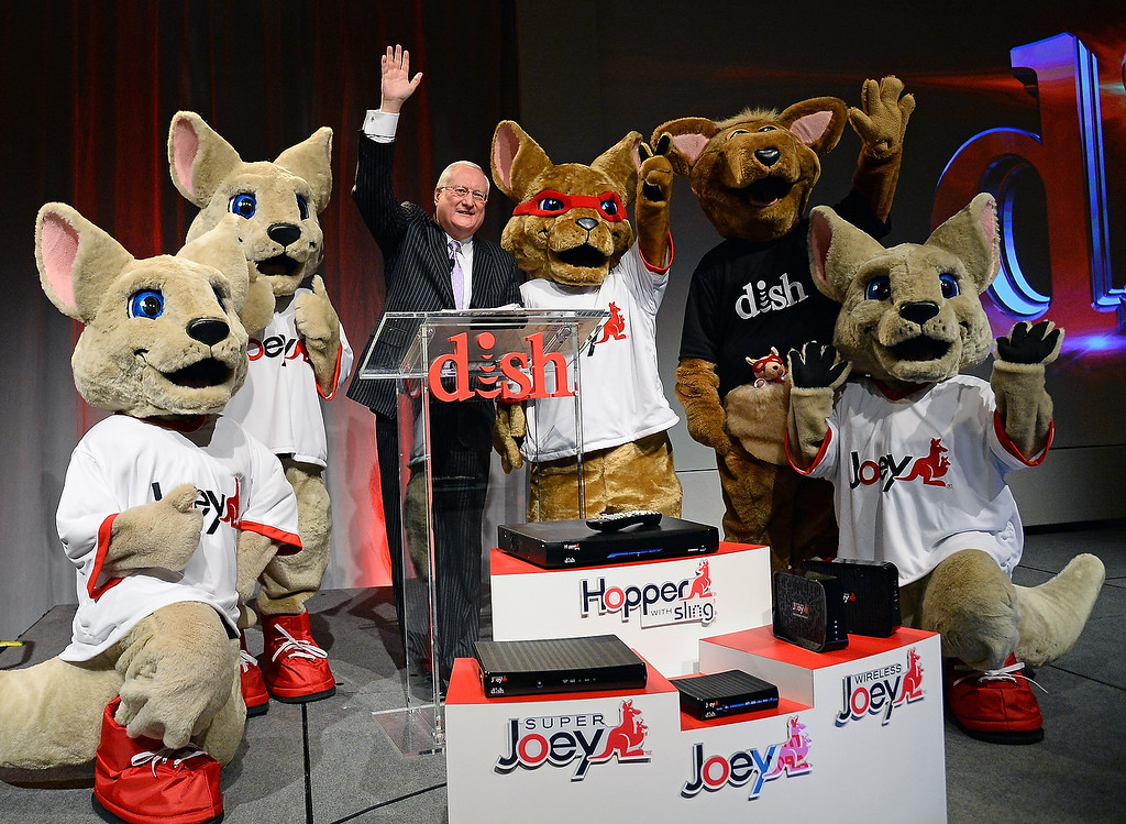 . DISH President and CEO Joe Clayton poses with kangaroo characters after speaking at a press event at the Mandalay Bay Convention Center for the 2014 International CES on January 6, 2014 in Las Vegas, Nevada. (Ethan Miller/Getty Images)