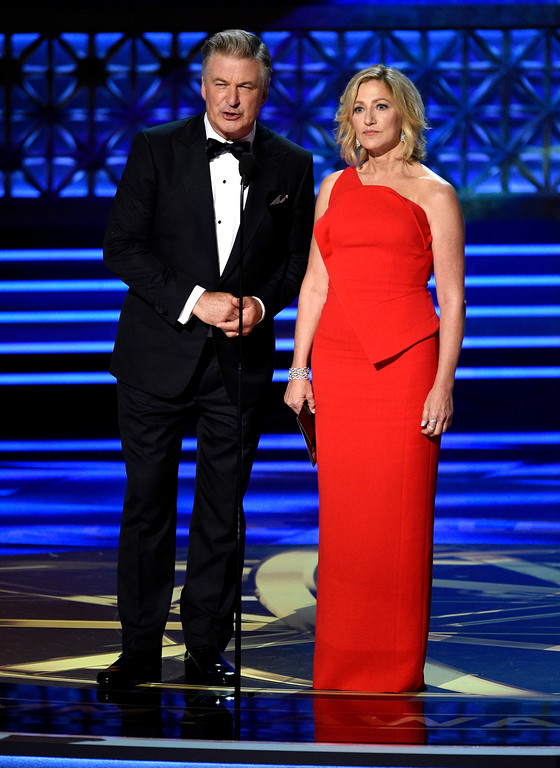 . Edie Falco, right, and Alec Baldwin present the award for outstanding lead actor in a comedy series at the 69th Primetime Emmy Awards on Sunday, Sept. 17, 2017, at the Microsoft Theater in Los Angeles. (Photo by Chris Pizzello/Invision/AP)