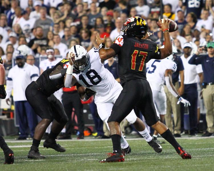 Maryland QB #17 Josh Jackson makes a pass under pressure from Penn State DE #18 Shaka Toney