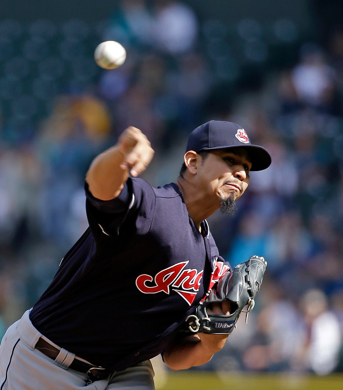 . Cleveland Indians starting pitcher Carlos Carrasco throws against the Seattle Mariners in the first inning of a baseball game Saturday, Sept. 23, 2017, in Seattle. (AP Photo/Elaine Thompson)