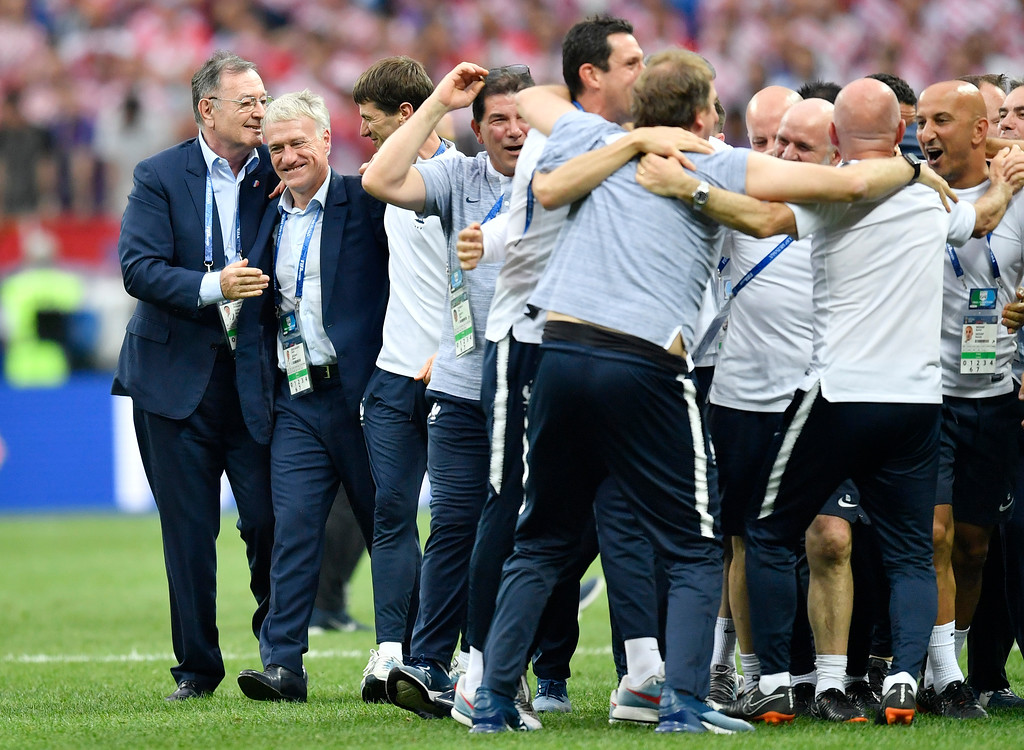 . France head coach Didier Deschamps, second from left, celebrates with his team after winning 4-2 during the final match between France and Croatia at the 2018 soccer World Cup in the Luzhniki Stadium in Moscow, Russia, Sunday, July 15, 2018. (AP Photo/Martin Meissner)