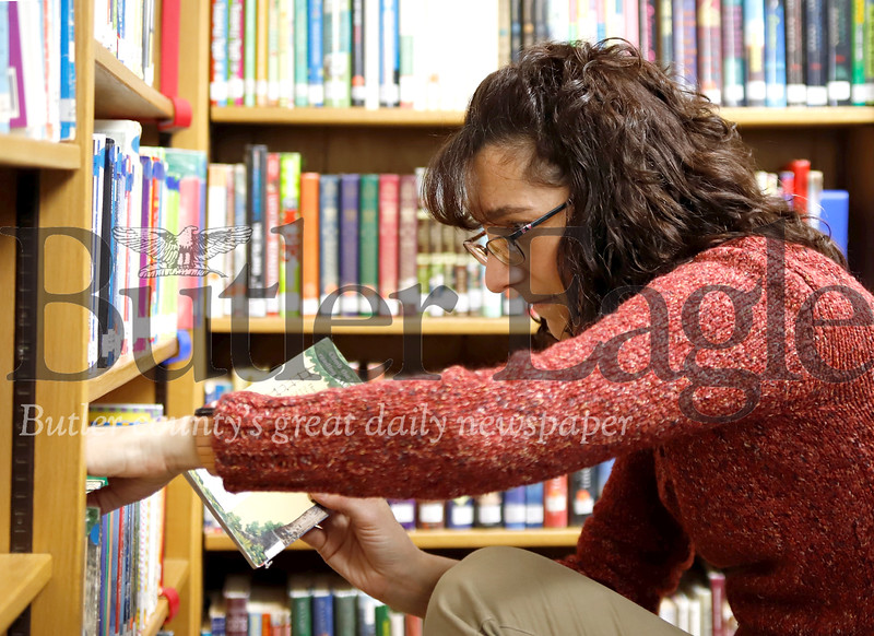 Library director Jill Hambley sorts through books Wednesday at the Prospect Library. Seb Foltz/Butler Eagle 01/22/20