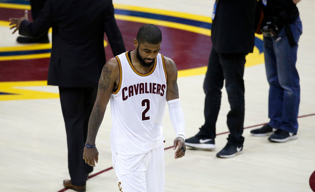 . Cleveland Cavaliers guard Kyrie Irving (2) walks off the court after the Cavaliers lost to the Golden State Warriors 118-113 in Game 3 of basketball\'s NBA Finals in Cleveland, Wednesday, June 7, 2017. (AP Photo/Ron Schwane)